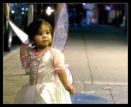 cute angel flower girl with fairy butterfly wings