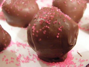 milk chocolate oreo truffles with pink candy sprinkles